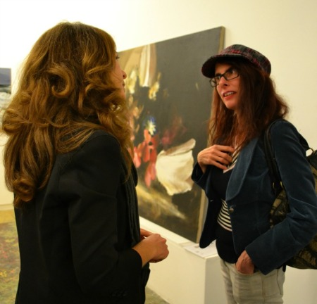 Gallery director, Nicola Stein (left) snapped in conversation